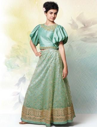 Teal green party wear net lehenga choli
