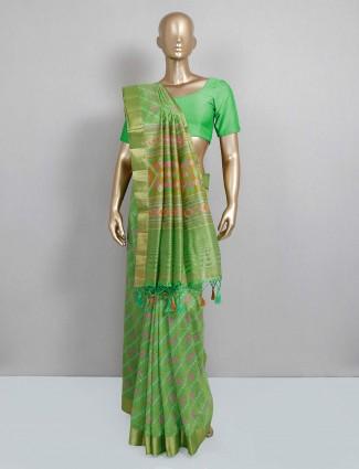 Beautiful green colored saree in cotton silk fabric