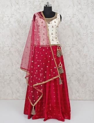 Beautiful raw silk magenta lehenga paired with off white blouse