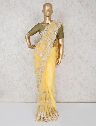 Beautiful yellow saree in net