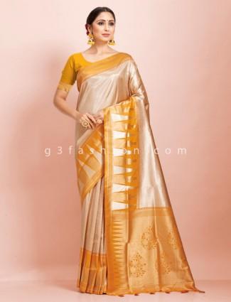 Beige and mustard yellow art kanjivaram traditional wear exclusive saree