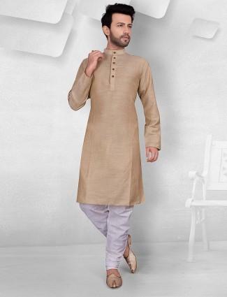 Beige color cottn fabric solid kurta suit
