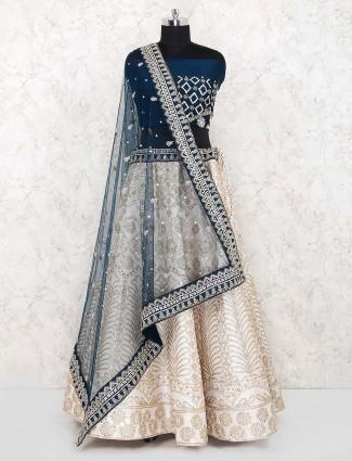 Beige color raw silk semi stitched lehenga choli