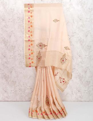 Beige colored festive wear saree in muga silk fabric