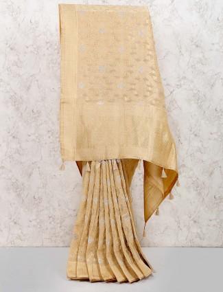 Beige hue beautiful festive saree in muga silk