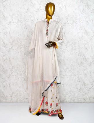 Beige hue cotton festive wear punjabi sharara suit