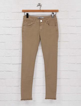 Beige hue denim solid comfortable jeans