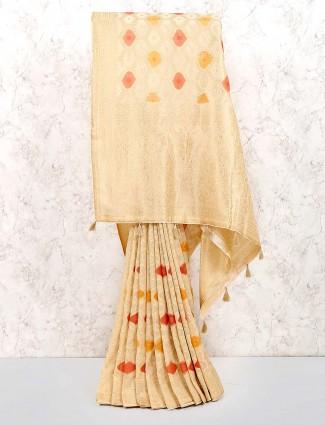 Beige hue festive saree in muga silk