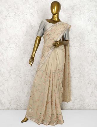 Beige hue georgette saree for wedding occasion