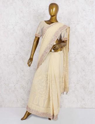 Beige hue lovely georgette festive saree