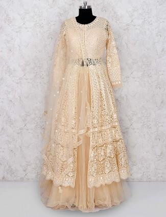 Beige hue net fabric designer lehenga cum salwar suit