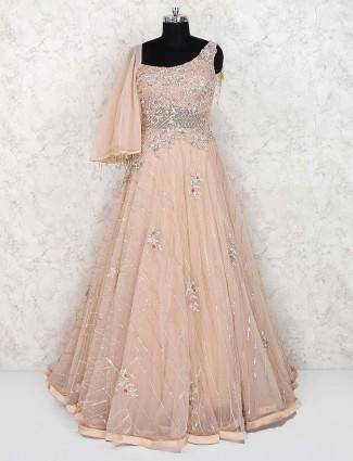Beige hue net party wear gown