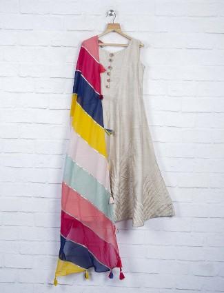 Beige hued raw silk anarkali suit