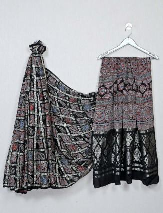 Black color festive wear bandhej saree