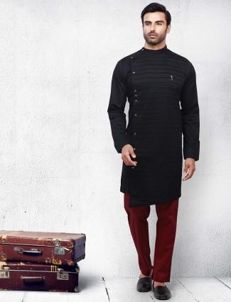 Black color solid pleats pattern kurta suit