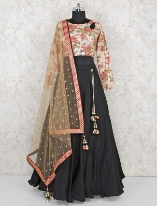 Black raw silk lehenga paired with printed blouse