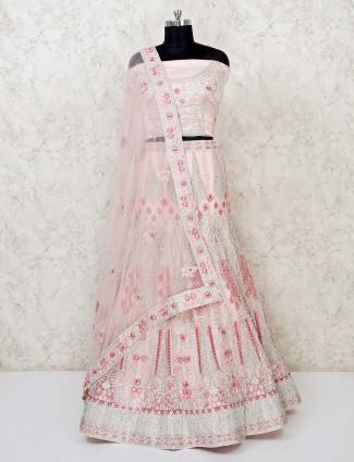 Bridal wear pink net semi stitched lehenga choli