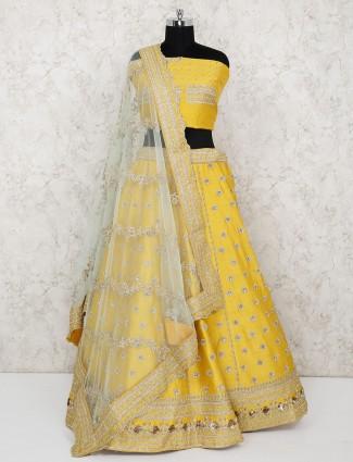 Bridal wear yellow raw silk semi stitched lehenga choli