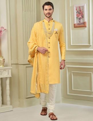 Bright yellow designer wedding wear indo western