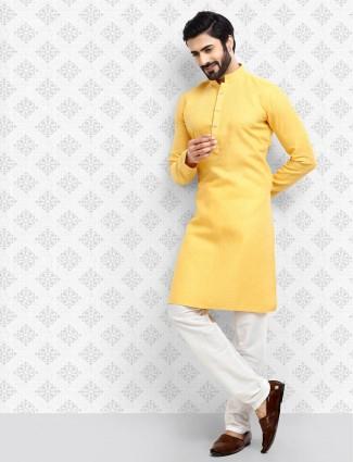 Bright yellow ethnic wear kurta suit for festive
