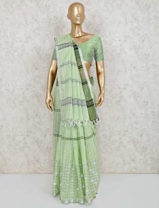 Checks green linen saree