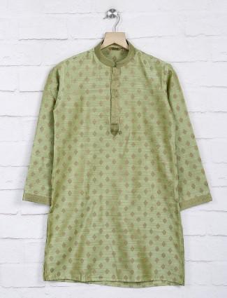 Cotton fabric light green hued festive kurta suit