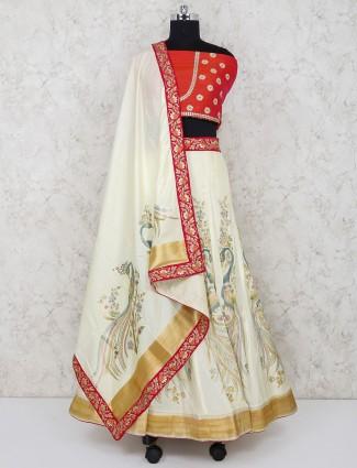Cream and orange silk fabric semi stitched lehenga choli