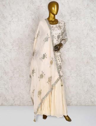 Cream color festive georgette punjabi sharara suit