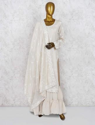 Cream color festive wear punjabi sharara suit in cream color