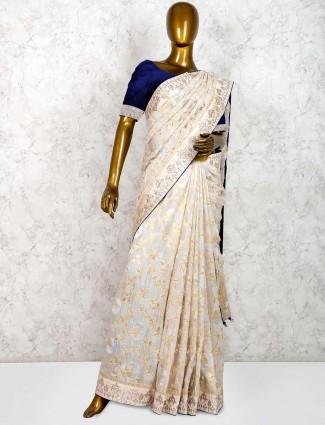 Cream color party wear muga silk saree