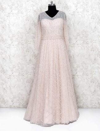 Cream color party wear net gown