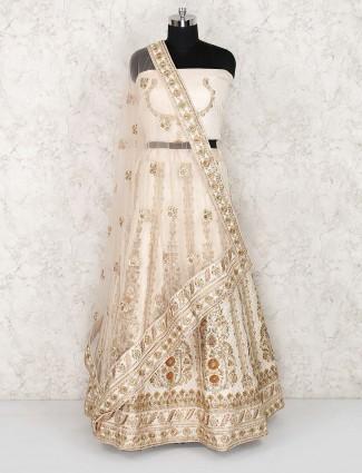 Cream color silk wedding semi stitched lehenga choli