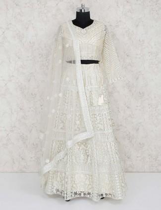 Cream hue net fabric wedding wear lehenga choli