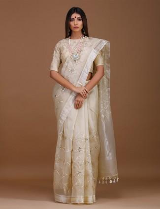 Cream hue saree in pure silk fabric