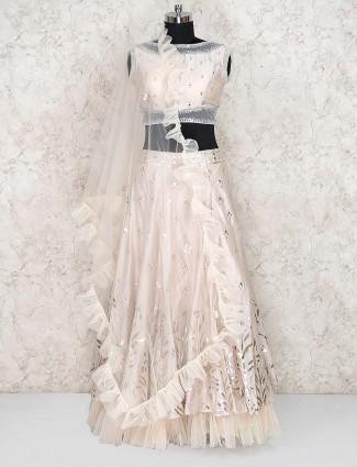 Cream hue silk fabric lehenga choli