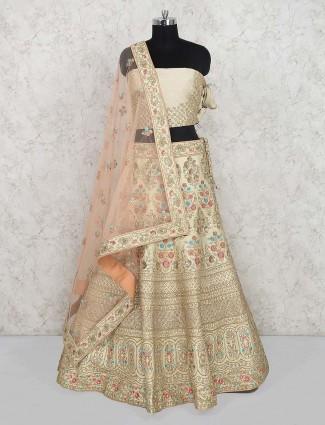 Cream hued bridal wear semi stitched lehenga choli