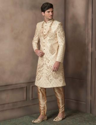 Cream sherwani with golden silk bottom