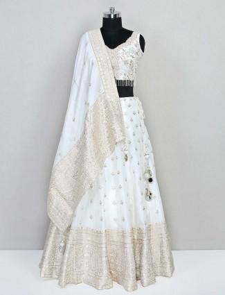 Cream silk fabric lehenga for reception function