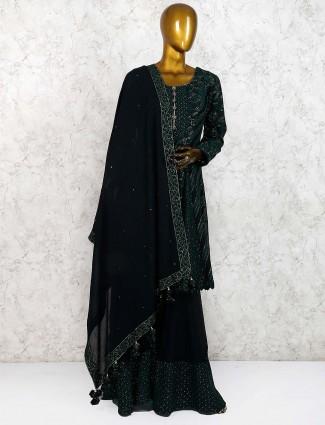 Dark green party wear georgette punjabi sharara suit