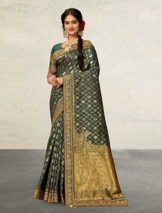 Dark green reception wear banarasi silk saree