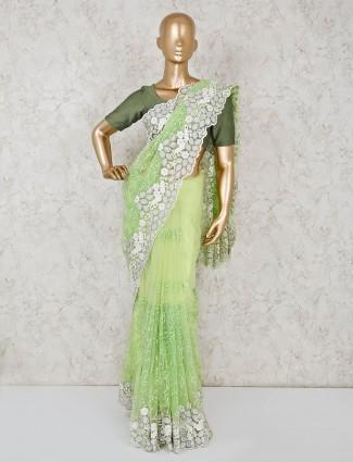 Designer green saree in net