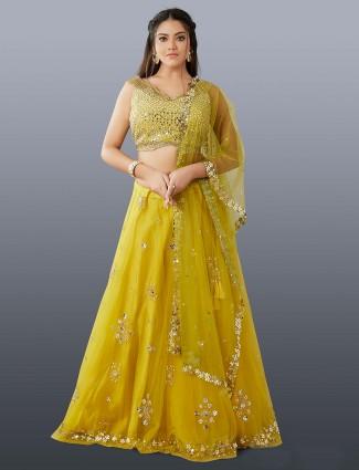 Dressy yellow net classy lehenga choli