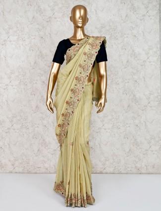 Embroidered beige saree in satin silk
