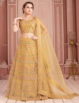 Embroidered yellow bridal lehenga choli in net