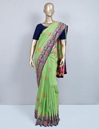 Exclusive green wedding saree in semi silk