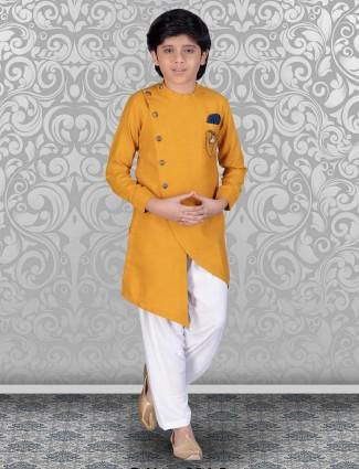 Festive mustard yellow solid cotton kurta suit