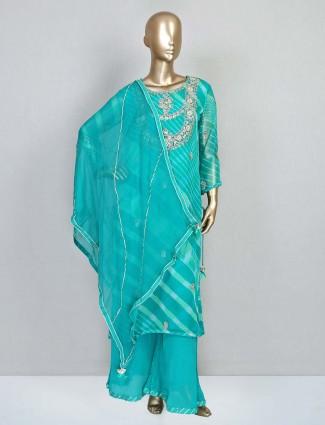 Festive wear green georgette palazzo salwar suit