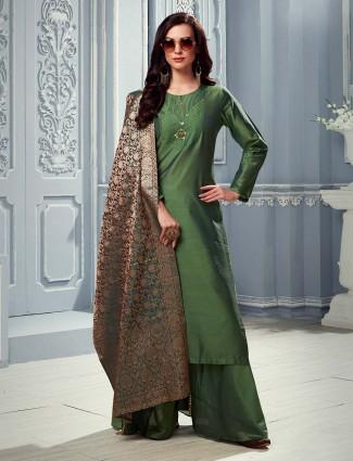 Festive wear green palazzo suit in cotton silk
