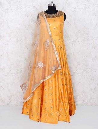 Golden hue festive wear floor length cotton silk anarkali salwar suit