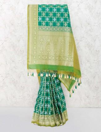 Gorgeous green color banarasi semi silk saree
